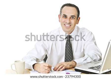 Happy office worker reviewing generic reports at his desk
