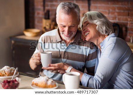 Happy old couple having coffee together #489717307