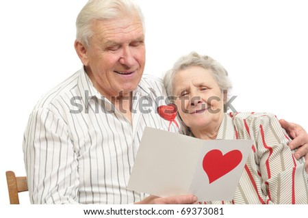 happy old couple with post-card on white background