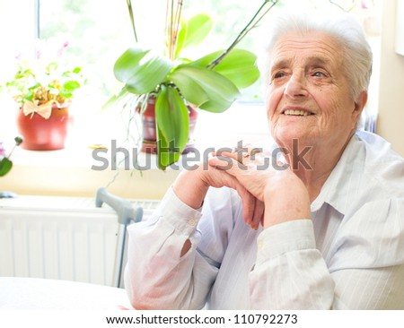 Happy old gray-haired woman