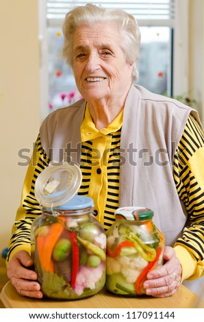Happy old gray-haired woman with veggies