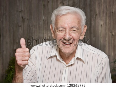Happy old man giving thumbs up