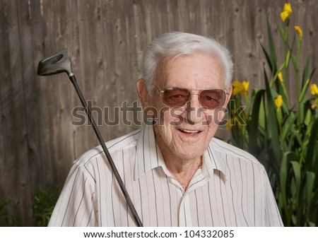 Happy old man senior citizen with golf club