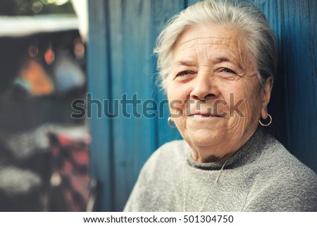 Happy old senior woman smiling outdoor portrait