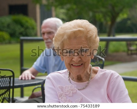 Happy old woman outside during daytime smiling