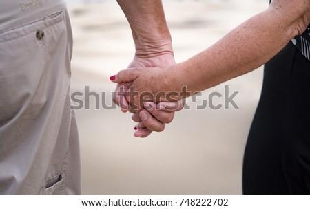 Happy older couple on the beach