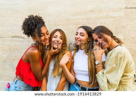 Happy only young women smiling , multiethnic. Trendy group of young women. Best friends have fun together joking and teasing each other. Celebration Cheerful Enjoying Party Leisure Happiness Concept