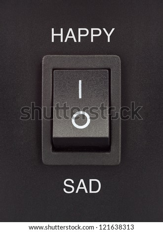 Happy or Sad black toggle switch on black surface positive negative