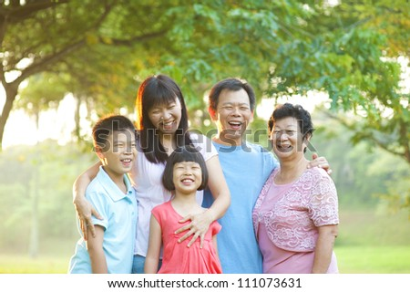 Happy outdoor family having great smile