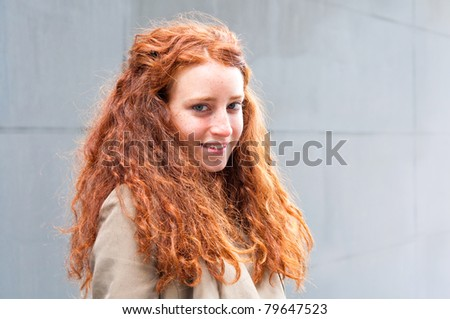 happy outdoor portrait of smiling charming young woman