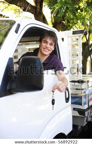 happy owner of a new truck showing car keys