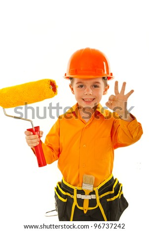 Happy painter kid boy holding paint roller and showing okay sign hand gesture isolated on white background - stock photo