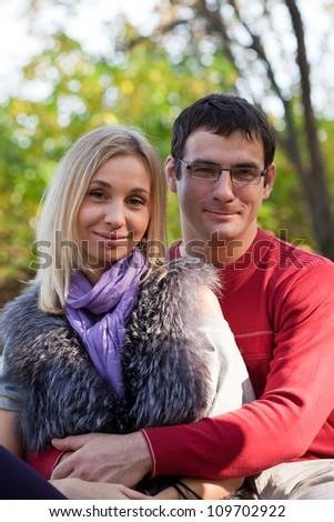 Happy pair walks in autumn park