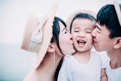 happy parent kissing the little boy