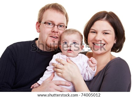 Happy parent smiling with baby girl in their arms