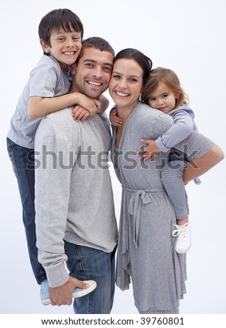 Happy parents giving children piggyback rides at home