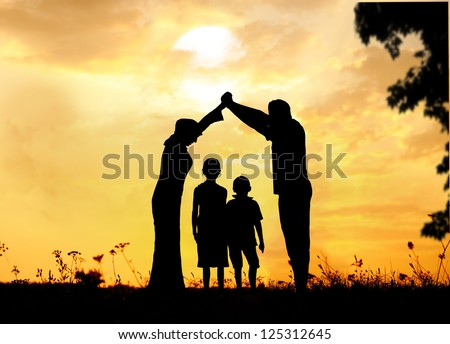 Happy parents making home for kids in beautiful nature