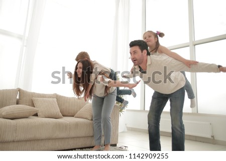 happy parents play with children at home. #1142909255