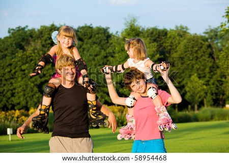 Happy parents with kids in roller skates