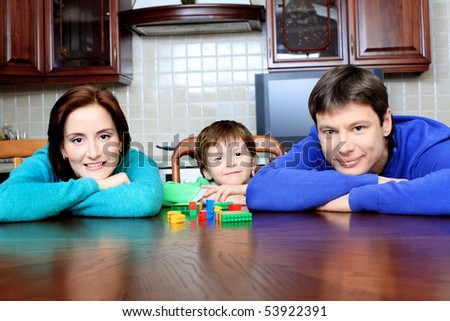 Happy parents with their son at home.