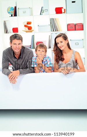 Happy parents with their son together at home.