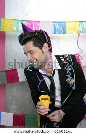 Happy party young man drinking enjoying alone laughing