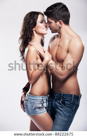 Happy passionate heterosexual couple in studio