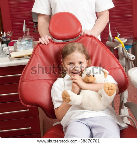 Happy patient at dental clinic (no-name teddy bear)