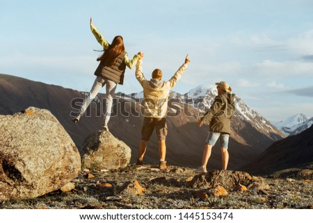 Happy people at sunset time in the mountains #1445153474
