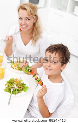 Happy people eating healthy food - stock photo