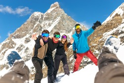 Happy People Group in Ski Equipment, Hugging Together, Looking at camera, Have Ski Resort Winter Mountain.