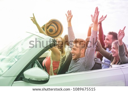 Happy people having fun in convertible car in summer vacation - Young tourist friends traveling in cabriolet auto - Radial purple and green filters editing - Main focus on left man face
