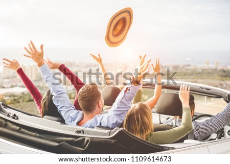 Happy people having fun in convertible car in summer vacation - Young tourist friends traveling in cabriolet auto - Youth lifestyle, travel and friendship concept - Main on center man head