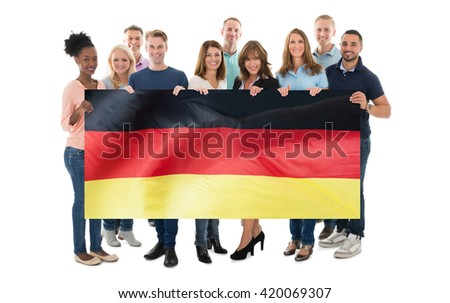 Happy People Holding German Flag Against White Background ストックフォト ©