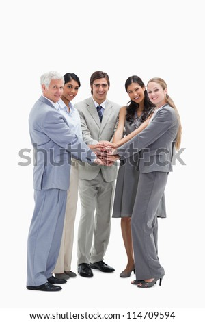Happy people putting their hands on each others against white background