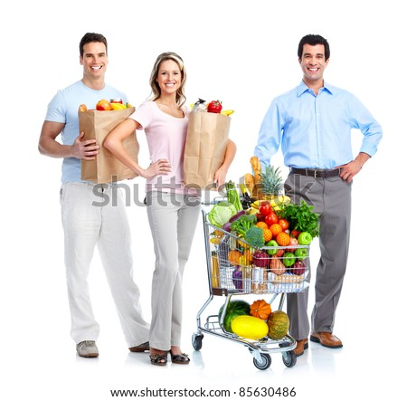 Happy people shopping with a  grocery cart. Isolated over white background.