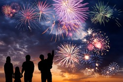 Happy peoples look at holiday fireworks in sky, celebration for family