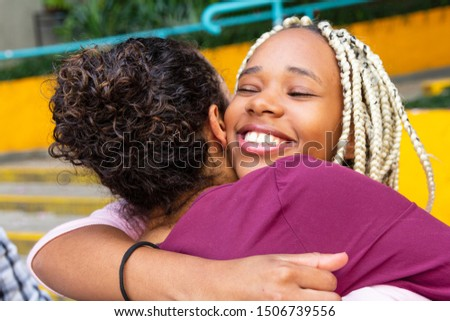 Happy person gives his friend a tight hug. Celebrations, reunions, meetings, friendship. Affection and union.
