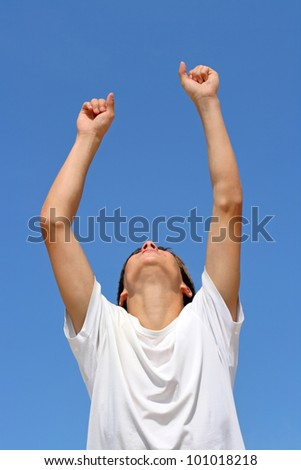 happy person jumping on blue sky background - stock photo