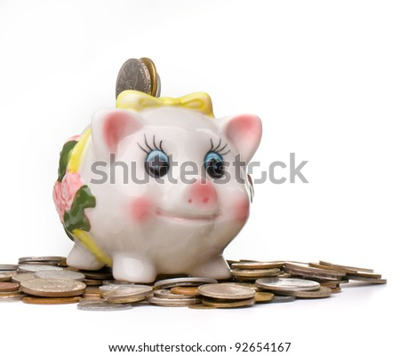 happy piggy bank on a pile of coins