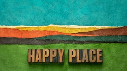 happy place - word abstract in vintage lettepress wood type against abstract paper landscape, joy and happiness concept - a memory, situation, or activity that makes you feel happy