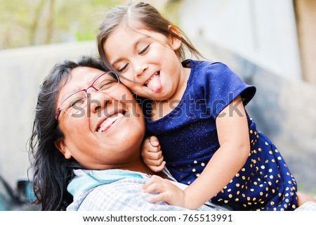 Happy playful latin mom with little daughter. #765513991