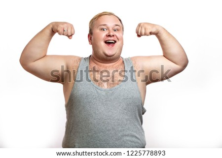 Happy plump softie fatso man posing in bodybuilder s stance, enjoying sport and healthy lifestyle.