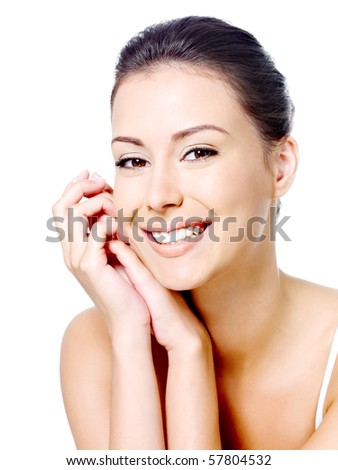 Happy portrait of beautiful smiling woman's face with clean fresh skin - isolated