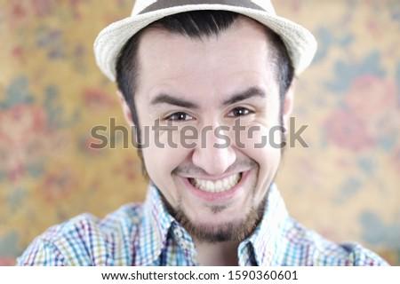 Happy portrait of man in hat