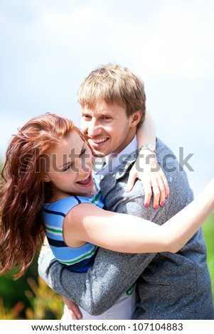 Happy positive romantic loving couple is hugging and laughing