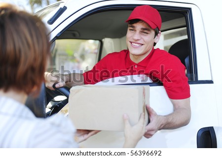 happy postal delivery courier in a van delivering package