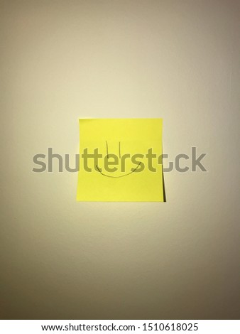 Happy posted note/sticky note with a light #1510618025