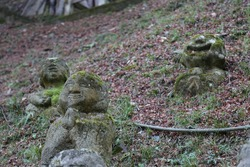 Happy Praying Carved Stone Memorial Statue at Adashino Nenbutsuji Buddhist Temple in Kyoto, Japan