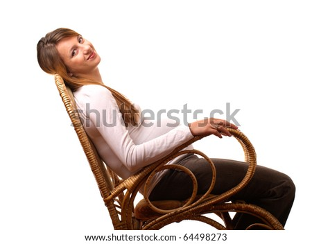 Happy pregnant woman in cain chair isolated on white